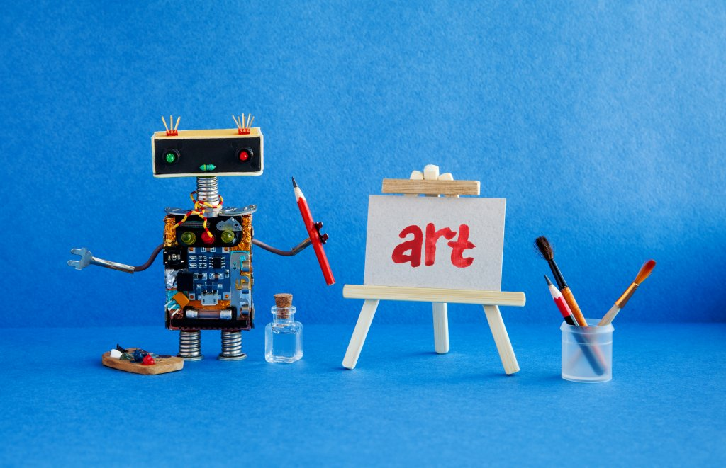 Art and robotic artificial intelligence concept. Robot artist, wooden easel and the handwritten word Art painted red watercolor.